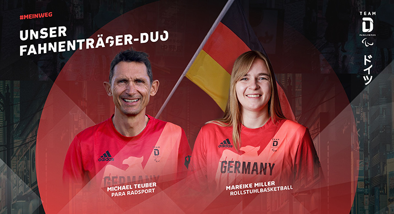 Mareike Miller und Michael Teuber tragen die deutsche Fahne